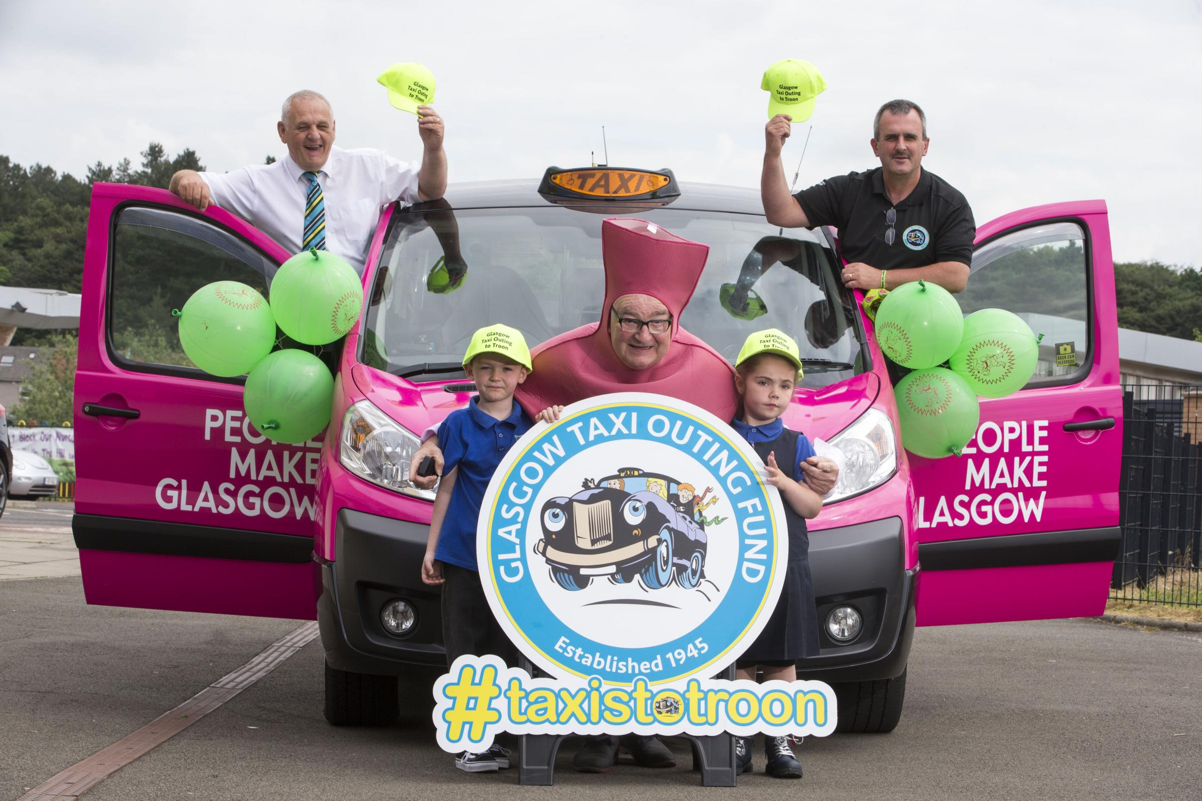 Langlands Primary School pupils help launch the annual Glasgow Taxis Outing fund Trip To Troon.Jim Buchanan (left on car) Stevie Lalley (right on car)Kenny Warren (centre kids)Kenzie Sinclair  6 (left) Skye Dunn 5 (right)