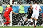 England striker Harry Kane, left, scores his side's second goal of the game during the Group G match against Tunisia at Russia 2018.