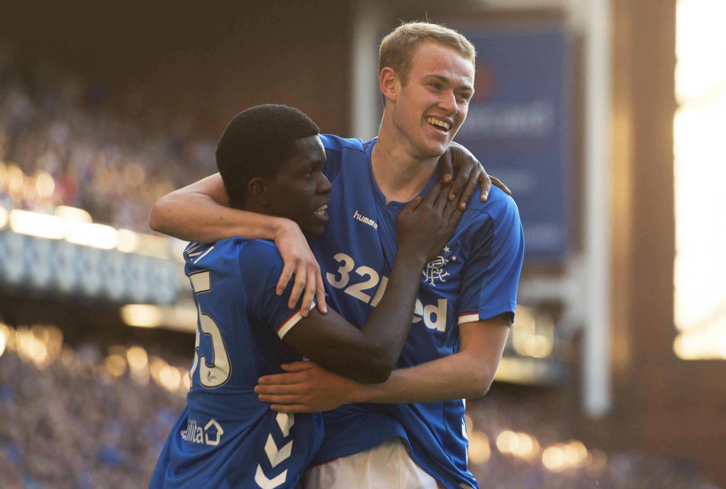 Zak Rudden, right, celebrates scoring against Bury with his fellow Rangers new boy Serge Atakayi.