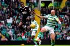 Mikel Miller battles with Celtic captain Scott Brown