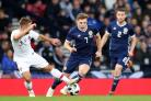 Portugal's Cedric Soares (left) and Scotland's James Forrest battle for the ball during the International Friendly match at Hampden Park, Glasgow. PRESS ASSOCIATION Photo. Picture date: Sunday October 14, 2018. See PA story SOCCER Sc