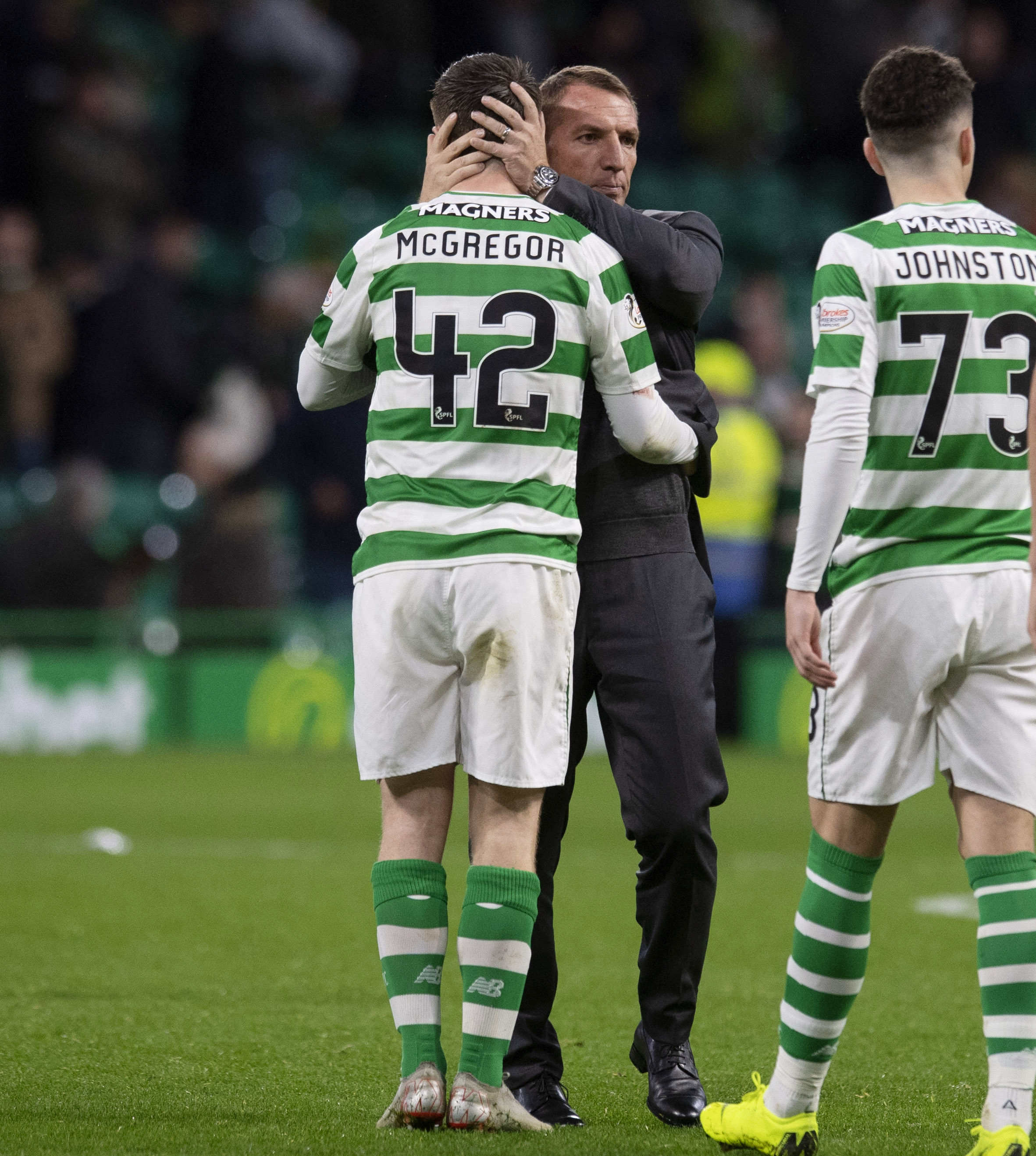 03/11/18 LADBROKES PREMIERSHIP.CELTIC V HEARTS (5-0).CELTIC PARK - CELTIC.Celtic manager Brendan Rodgers celebrates with Callum McGregor at full time.