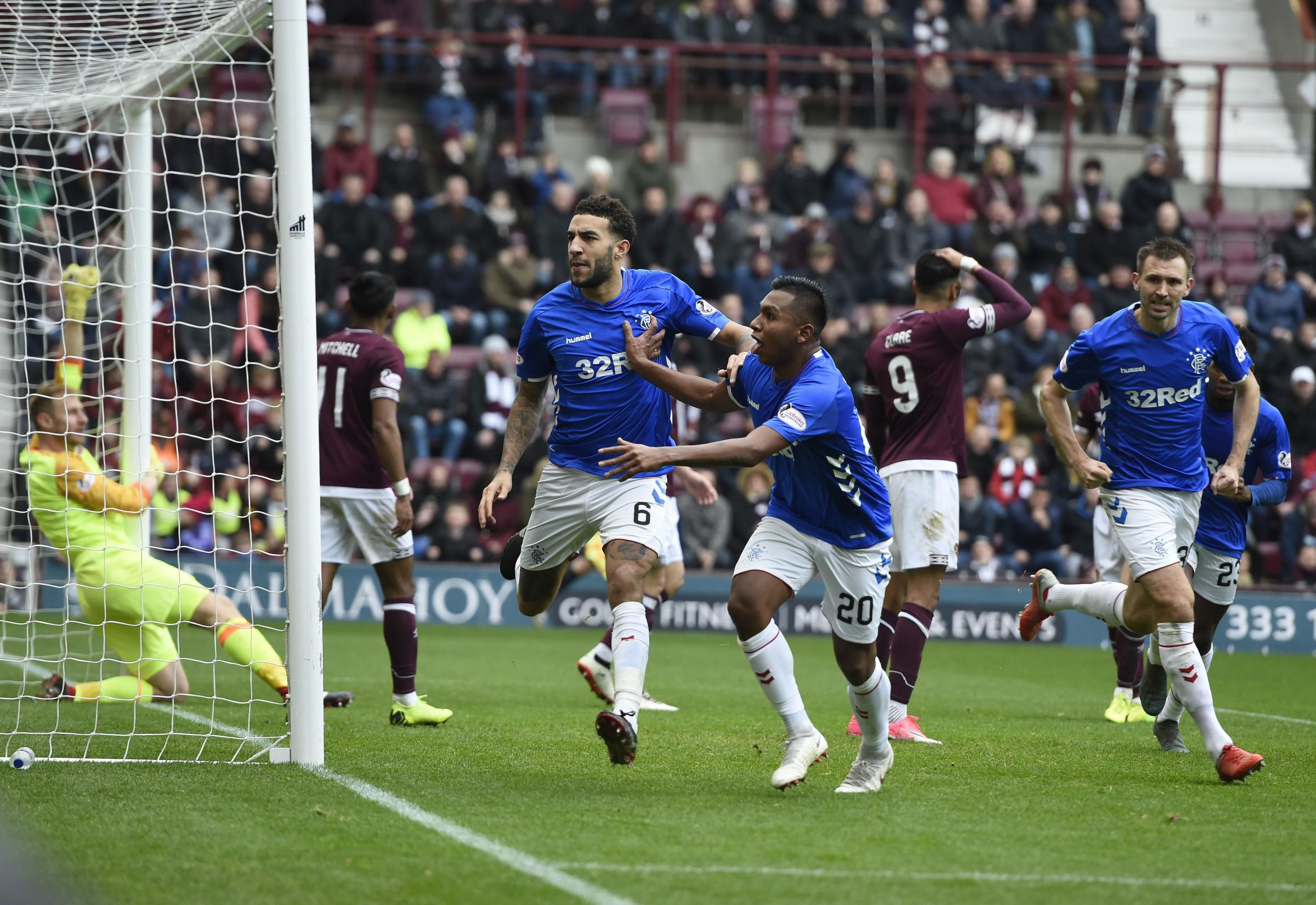 Rangers Connor Goldson celebrates with team-mate Alfredo Morelos in front of the Hearts fans after scoring the first Rangers goal during the Ladbrokes Scottish Premiership match at Tynecastle Stadium, Edinburgh. PRESS ASSOCIATION Photo. Picture date: Sund