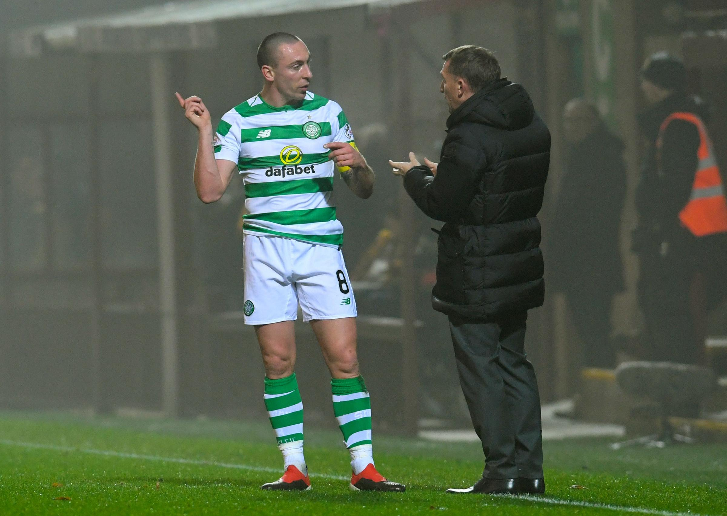 05/12/18 LADBROKES PREMIERSHIP.MOTHERWELL v CELTIC.FIR PARK - MOTHERWELL.Celtic's Scott Brown in discussion with Celtic manager Brendan Rodgers (right).