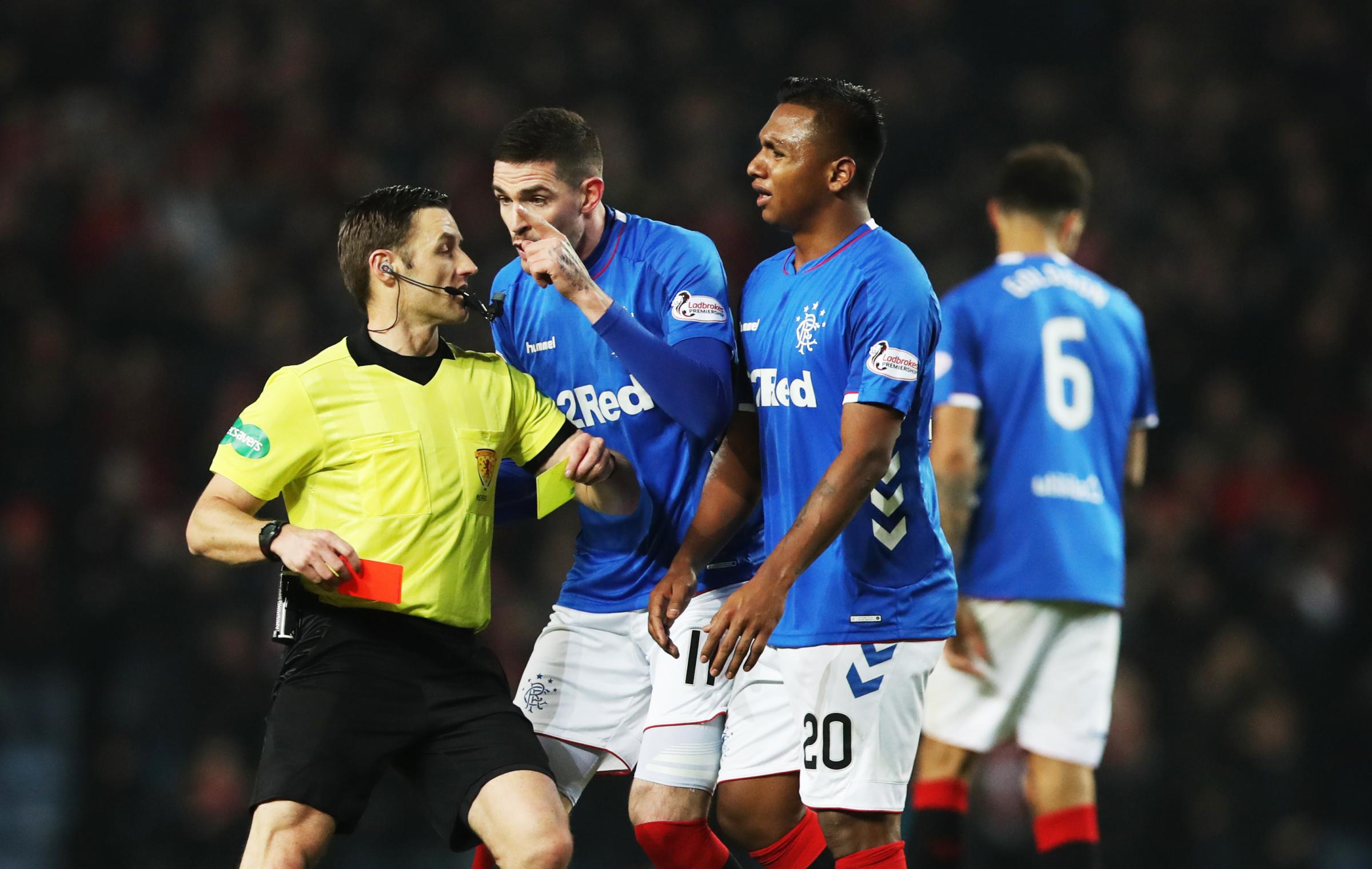 GLASGOW, SCOTLAND - DECEMBER 05: Kyle Lafferty of Rangers remonstrates with referee Steven McLean after Alfredo Morelos of Rangers lis given a second yellow card during the Scottish Ladbrokes Premiership match between Rangers and Aberdeen at Ibrox Stadium
