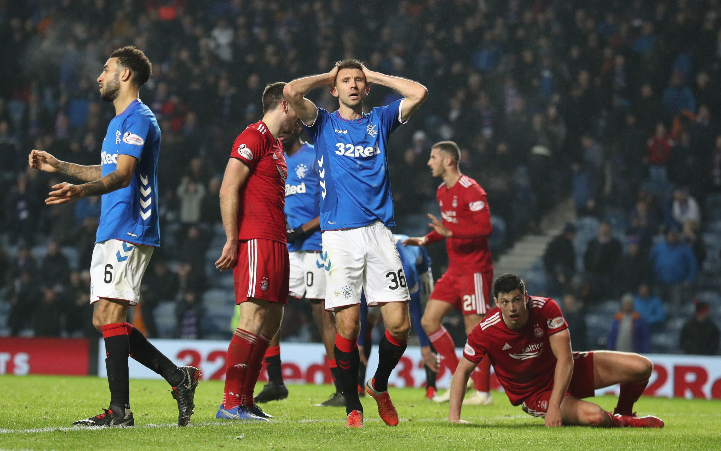Gareth McAuley reacts after a chance during the Ladbrokes Scottish Premiership match at Ibrox