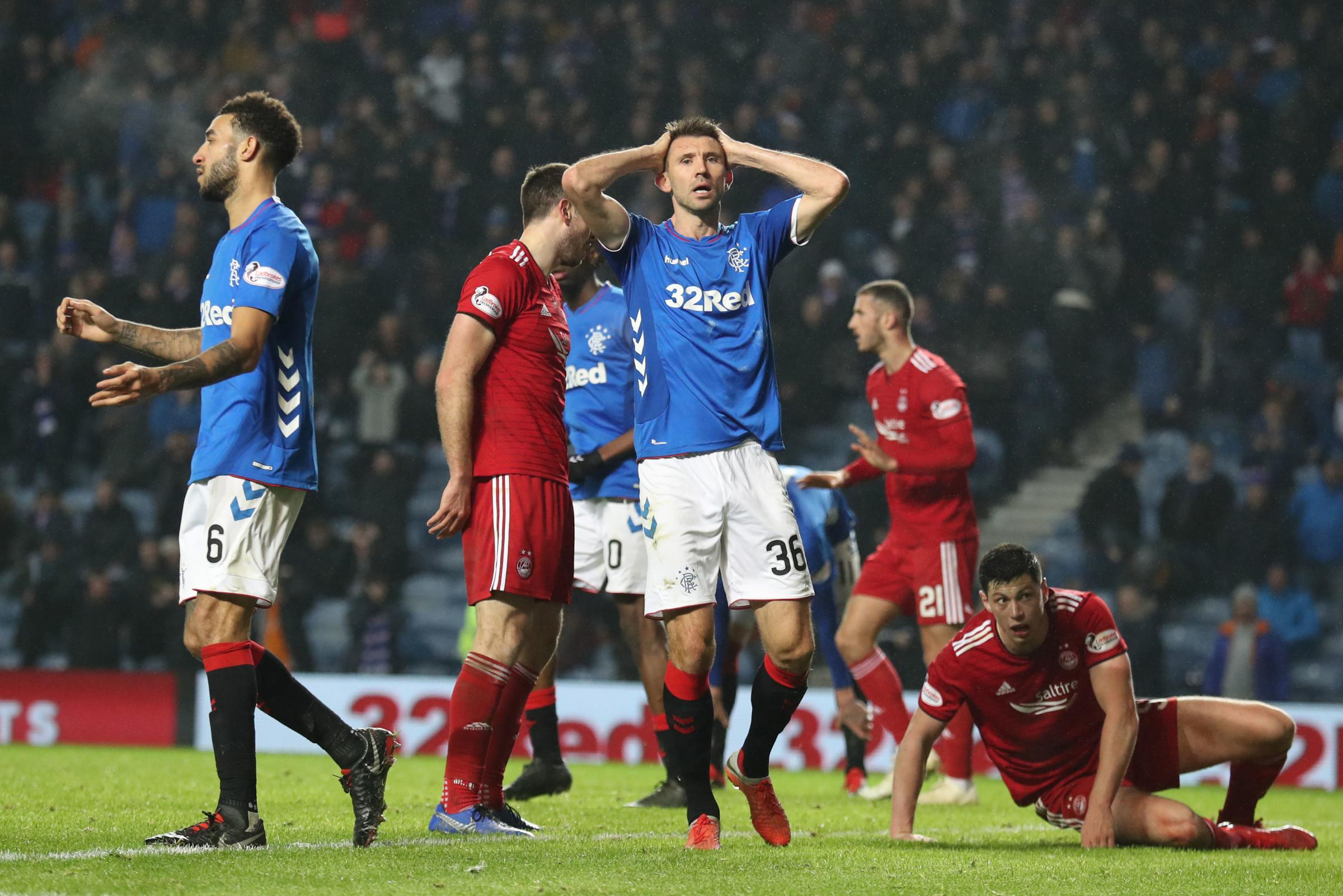 Gareth McAuley understands Steven Gerrard's anger after Rangers' eighth red card of the campaign
