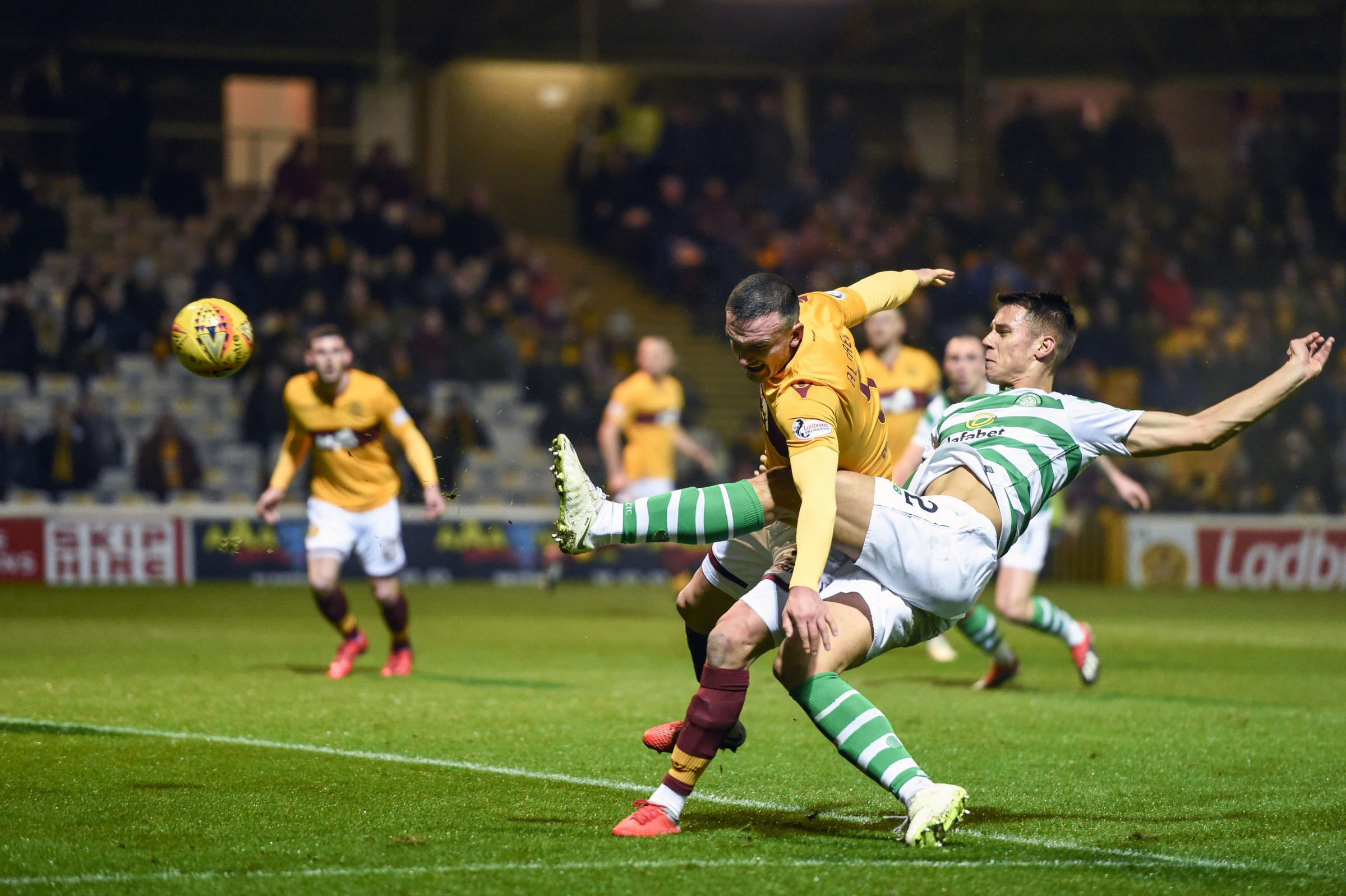Celtic's Filip Benkovic scores as he is challenged by  Motherwell's Tom Aldred but it is later disallowed during the Ladbrokes Scottish Premiership match at Fir Park, Motherwell. PRESS ASSOCIATION Photo. Picture date: Wednesday December 5, 2018. S