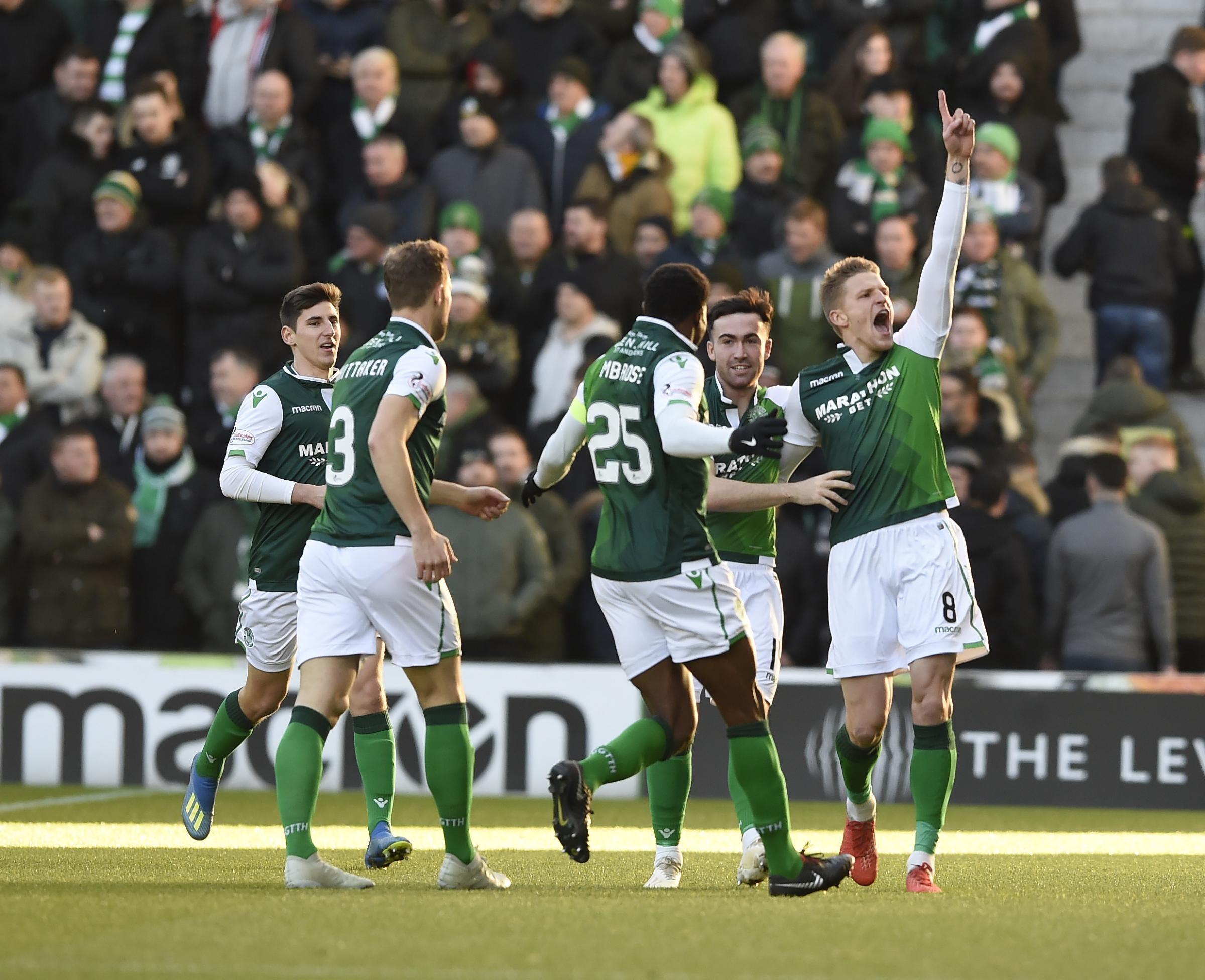 Hibernian's Vykintas Slivka (8) celebrates scoring his side's first goal of the game with team-mates Efe Ambrose (25) Stevie Mallan (14) and Steven Whittaker (3) during the Ladbrokes Scottish Premiership match at Easter Road, Edinburgh. PRESS ASSO