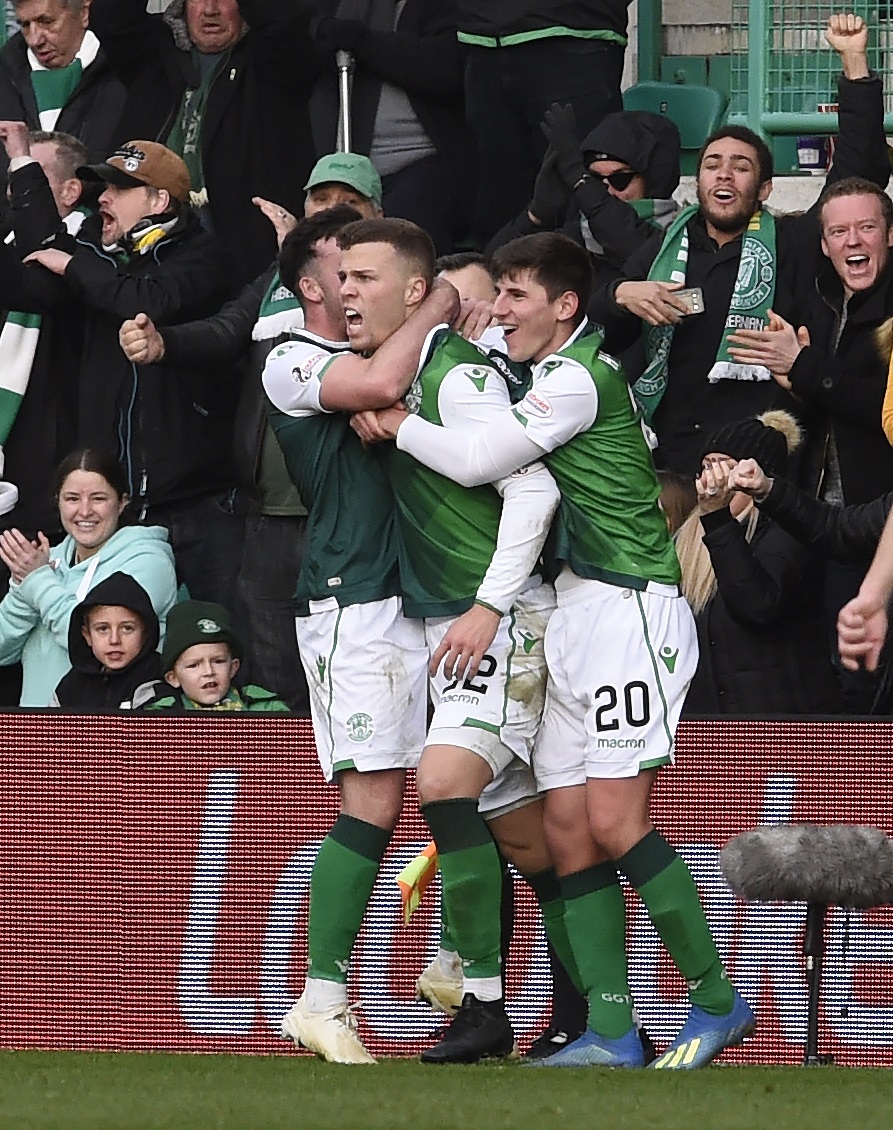 Hibernian's Florian Kamberi (22) celebrates with Stevie Mallan (14) and Emerson Hyndman (20) after scoring the second goal during the Ladbrokes Scottish Premiership match at Easter Road, Edinburgh. PRESS ASSOCIATION Photo. Picture date: Sunday Decembe
