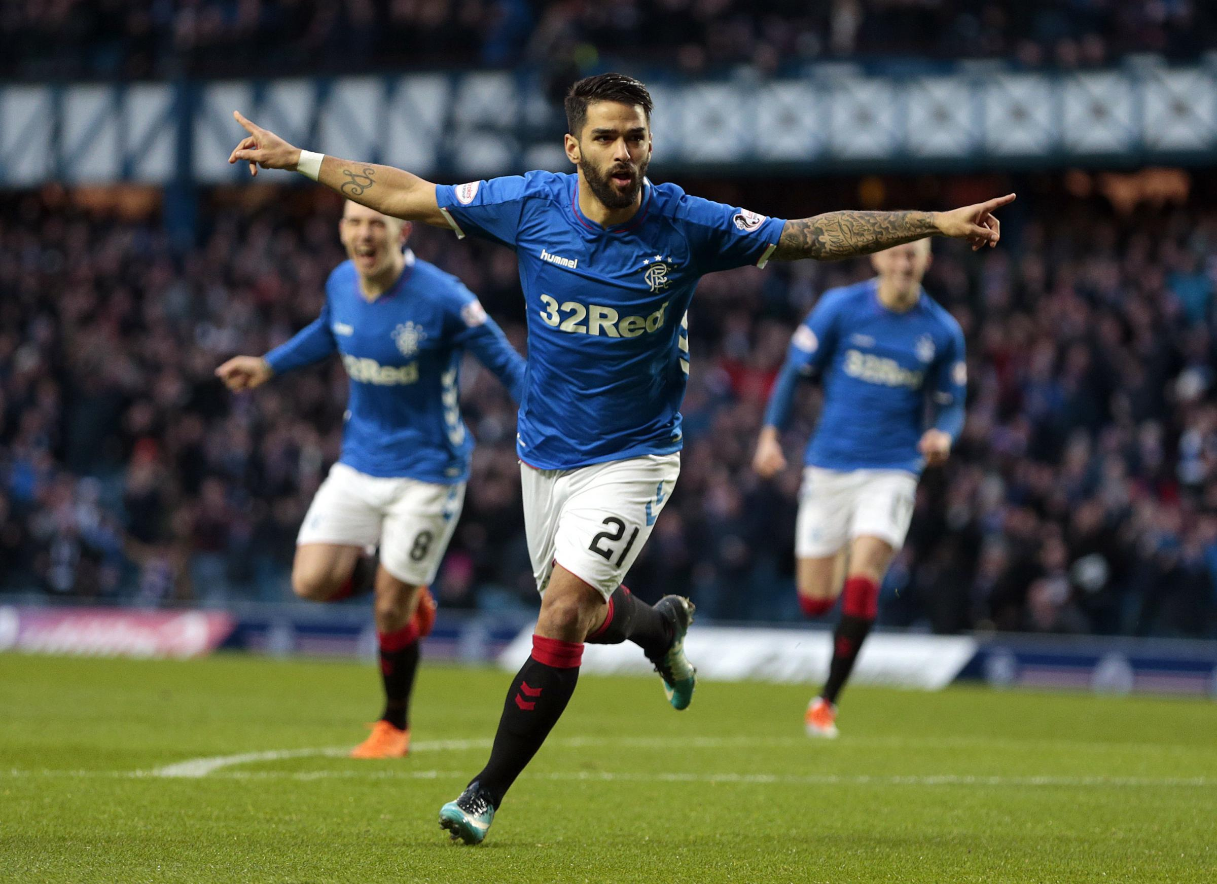 Daniel Candeias wheels away after scoring an early winner for Rangers against Hamilton.