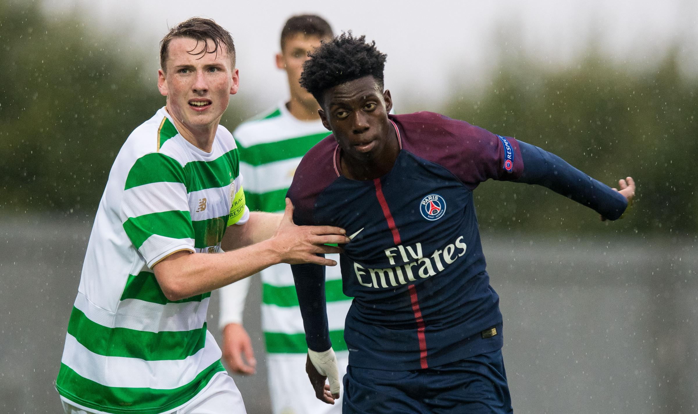 Regan Hendry of Celtic (left) in action against Timothy Weah of PSG