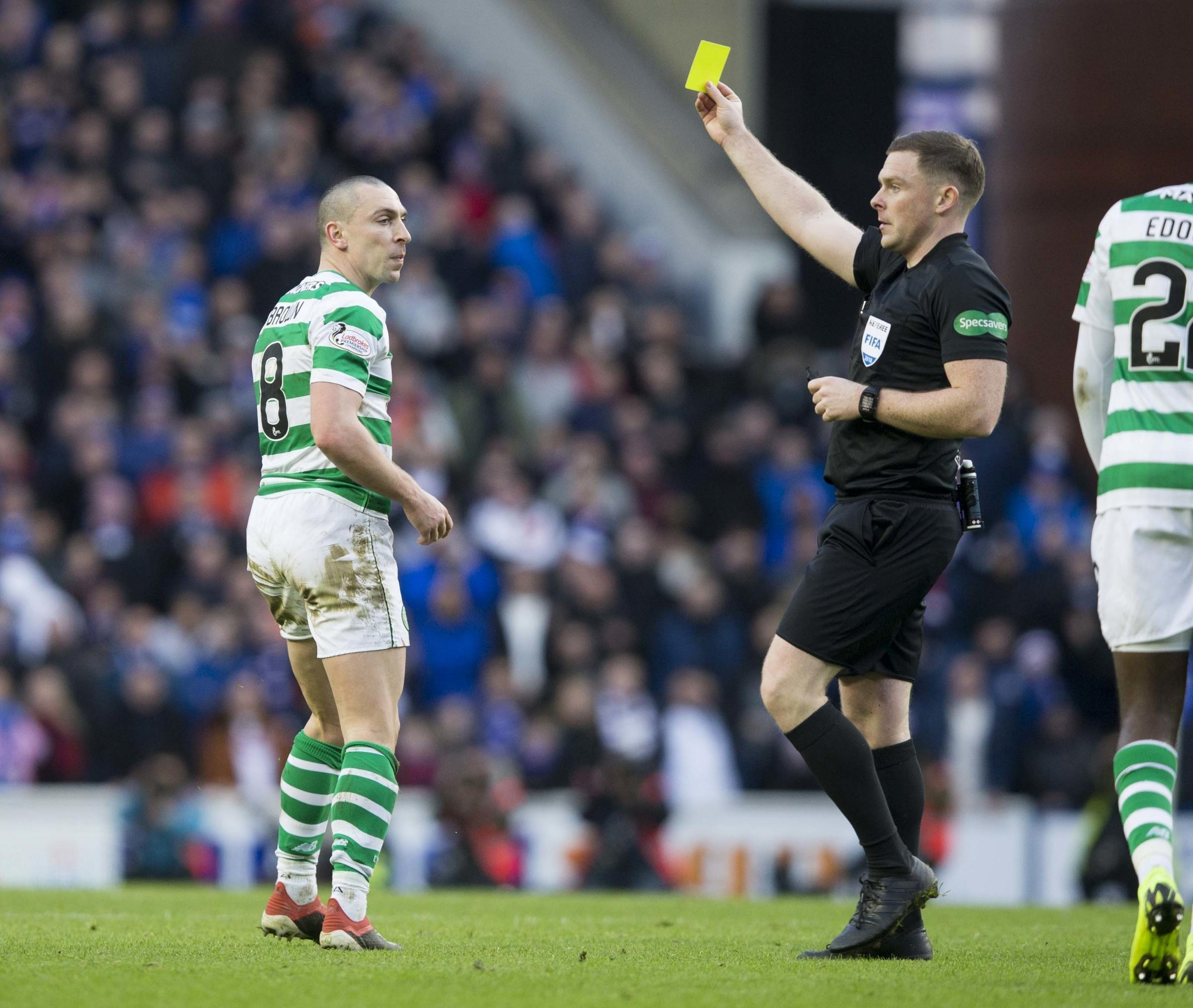 Celtic�s Scott Brown is booked during the Ladbrokes Scottish Premiership match at Ibrox Stadium, Glasgow. PRESS ASSOCIATION Photo. Picture date: Saturday December 29, 2018. See PA story SOCCER Rangers. Photo credit should read: Jeff Holmes/PA Wire