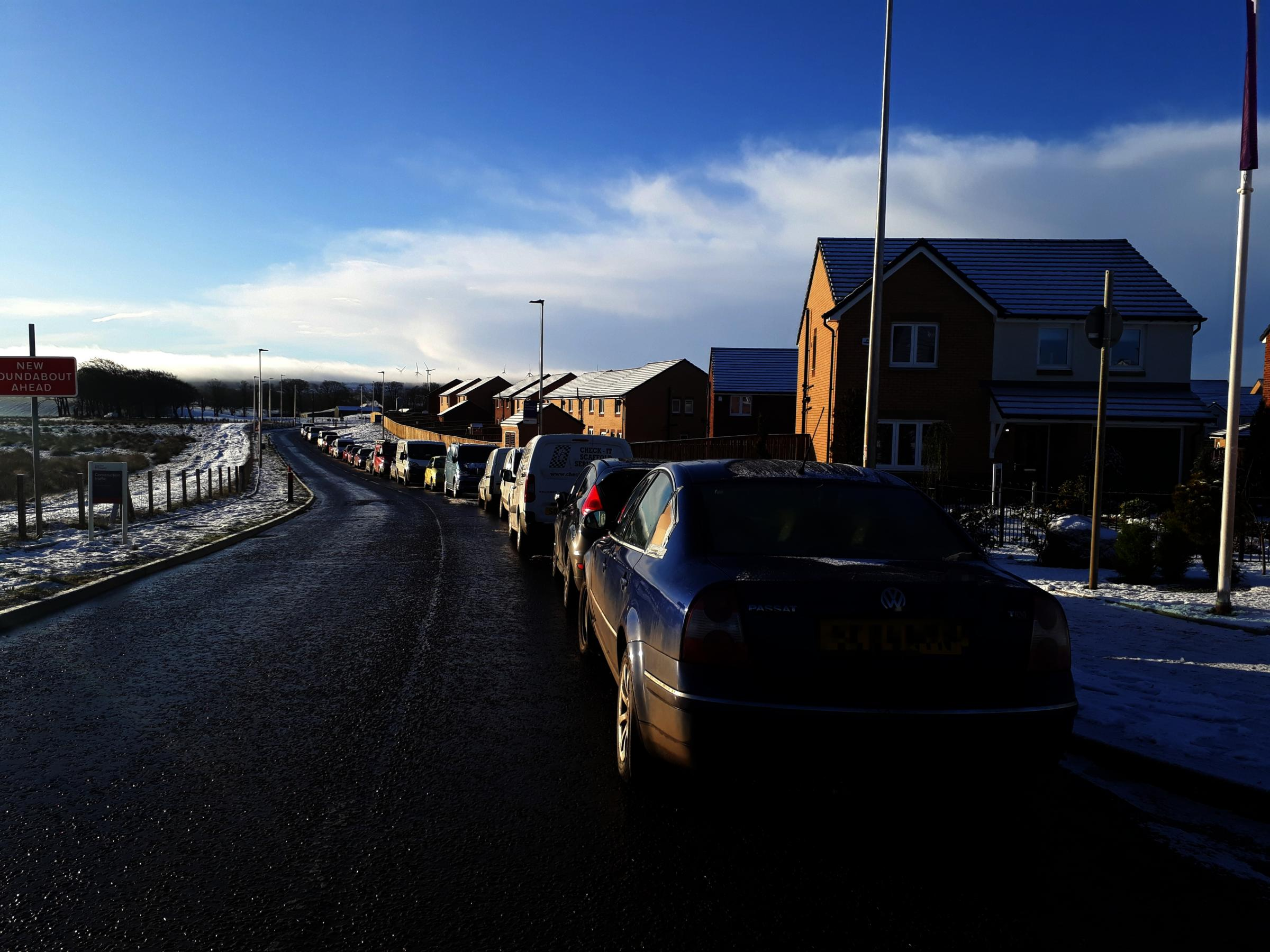 Cars parked along Auldhouse Road in East Kilbride have sparked accident fears