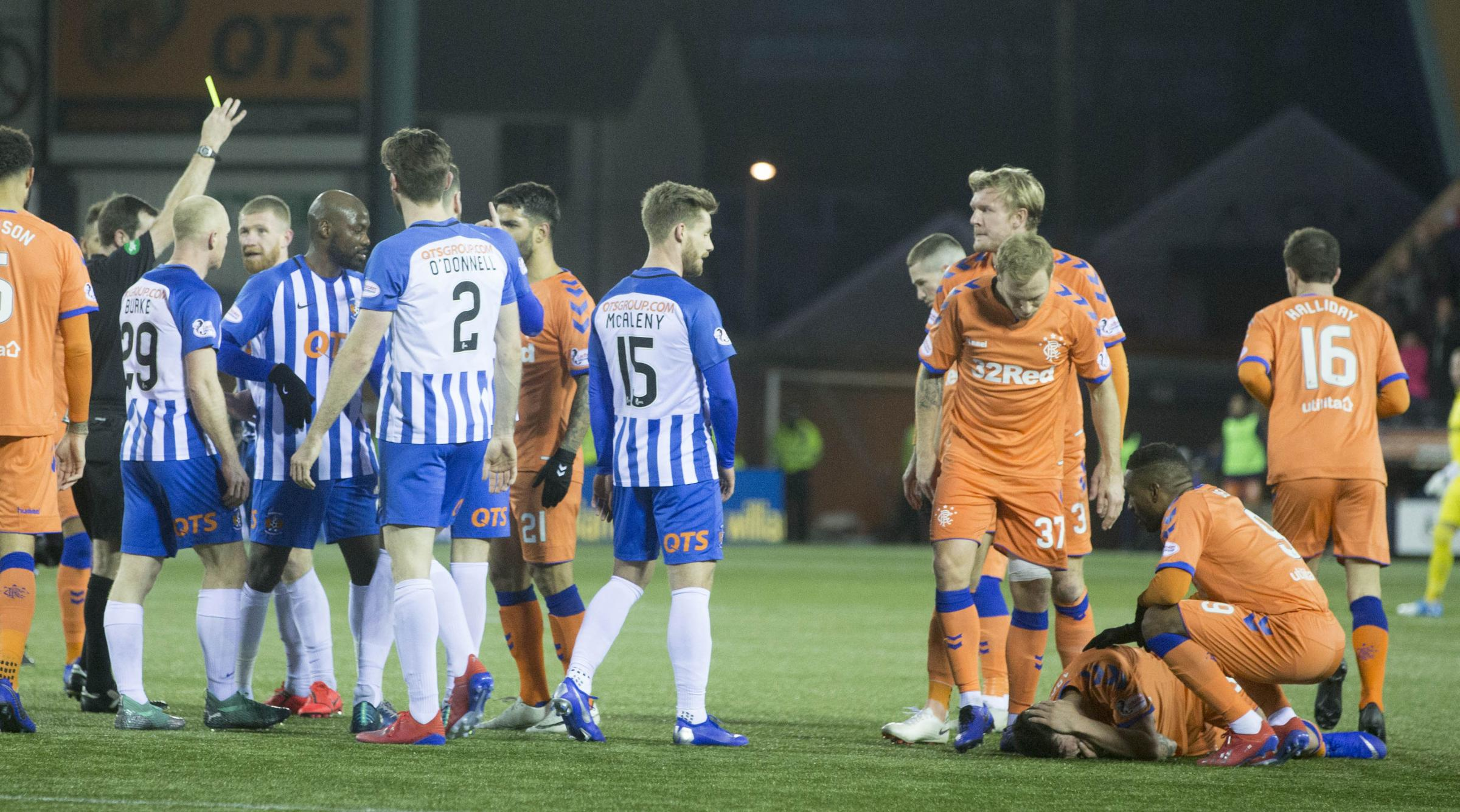 Kilmarnock' s Alan Power clashes with Rangers' Ryan Jack in first half gets booked during the William Hill Scottish Cup fifth round match at Rugby Park