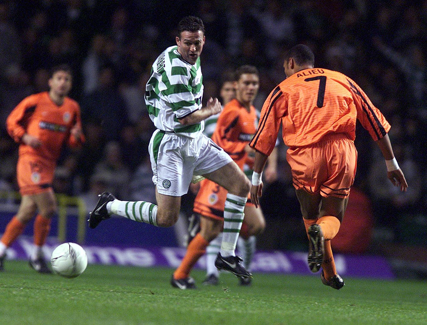 Paul Lambert keeps his eye on the ball during Celtic's match against Valencia in 2001