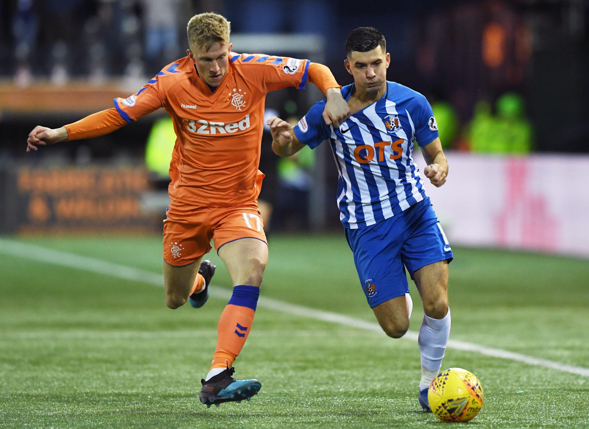 Kilmarnock's Jordan Jones (right) takes on Rangers' Ross McCrorie
