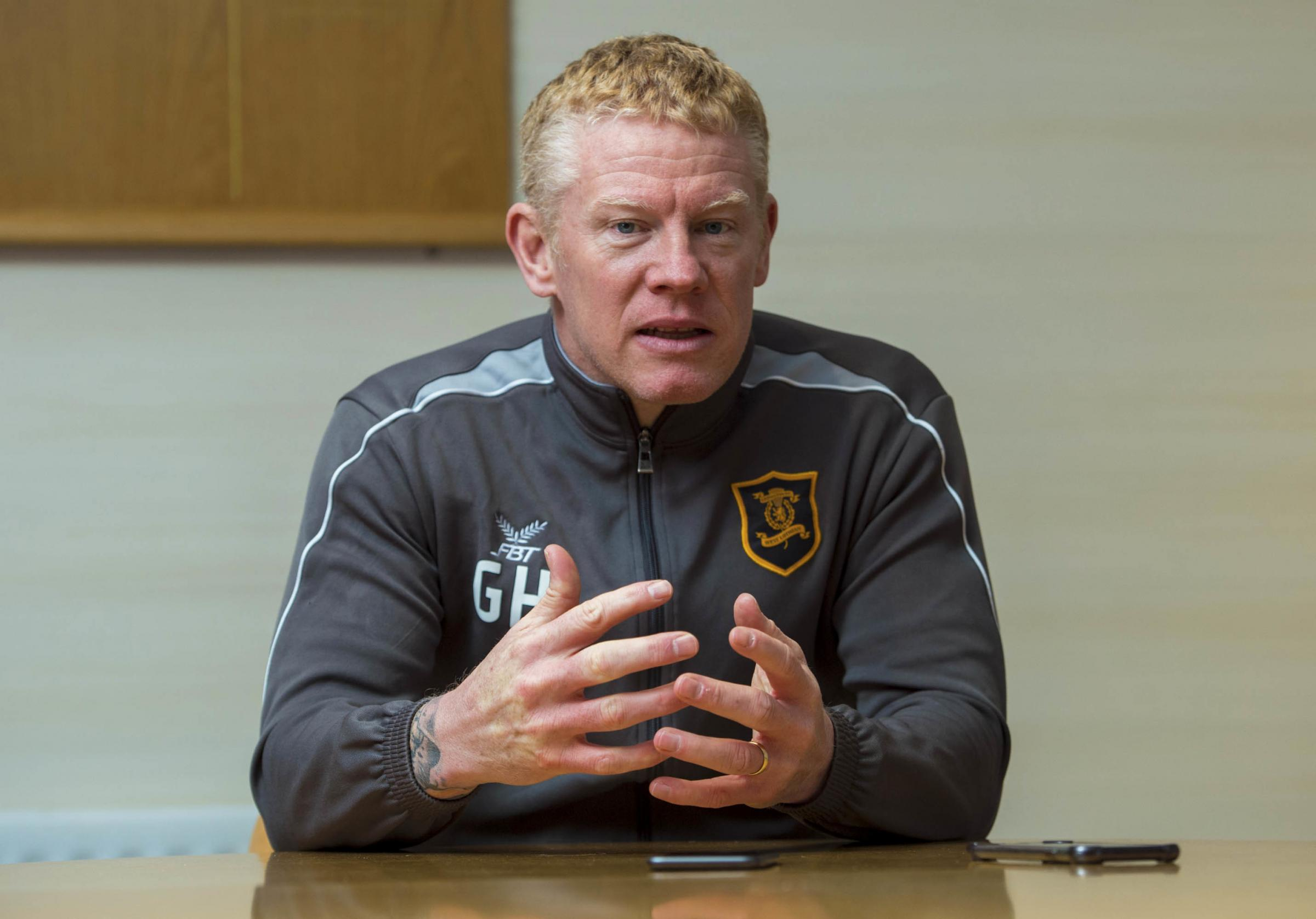 Gary Holt has defended Livingston's right to have an artificial pitch.
