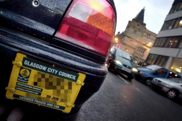PICTURE TO ILLUSTRATE OUT OF DATE TAXI LICENCE PLATES...PICTURE BY CHRIS JAMES.