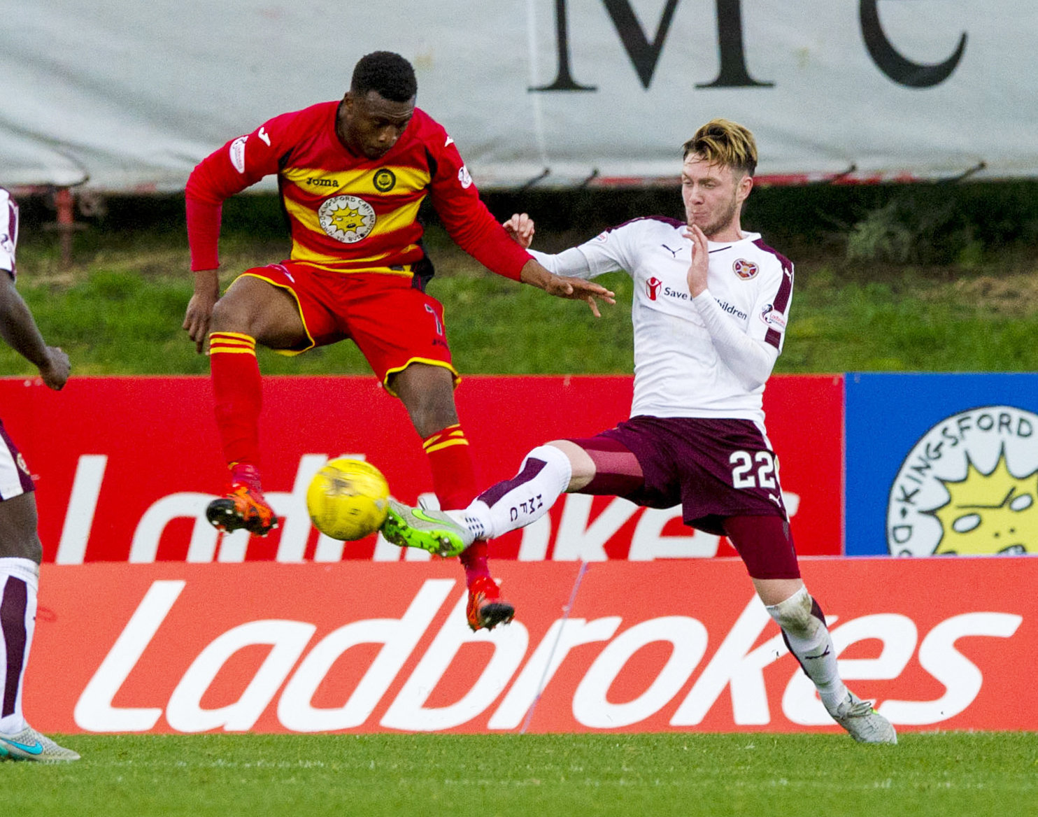 PARTICK THISTLE v HEARTS (4-0) .  FIRHILL STADIUM - GLASGOW  .  Partick's David Amoo (centre) retains possession from Hearts' Jordan McGhee (22).