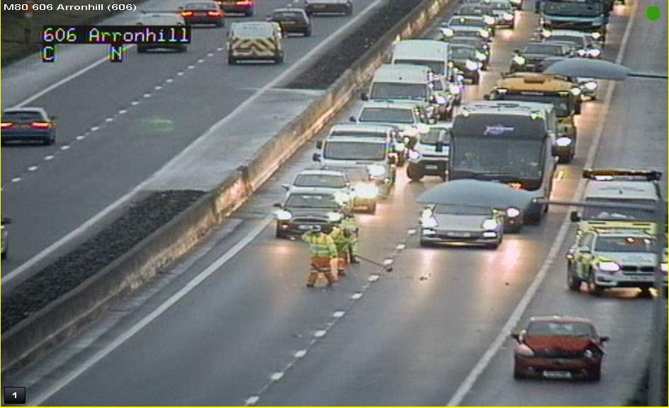 Tailbacks as police hold traffic on busy motorway while glass is swept up