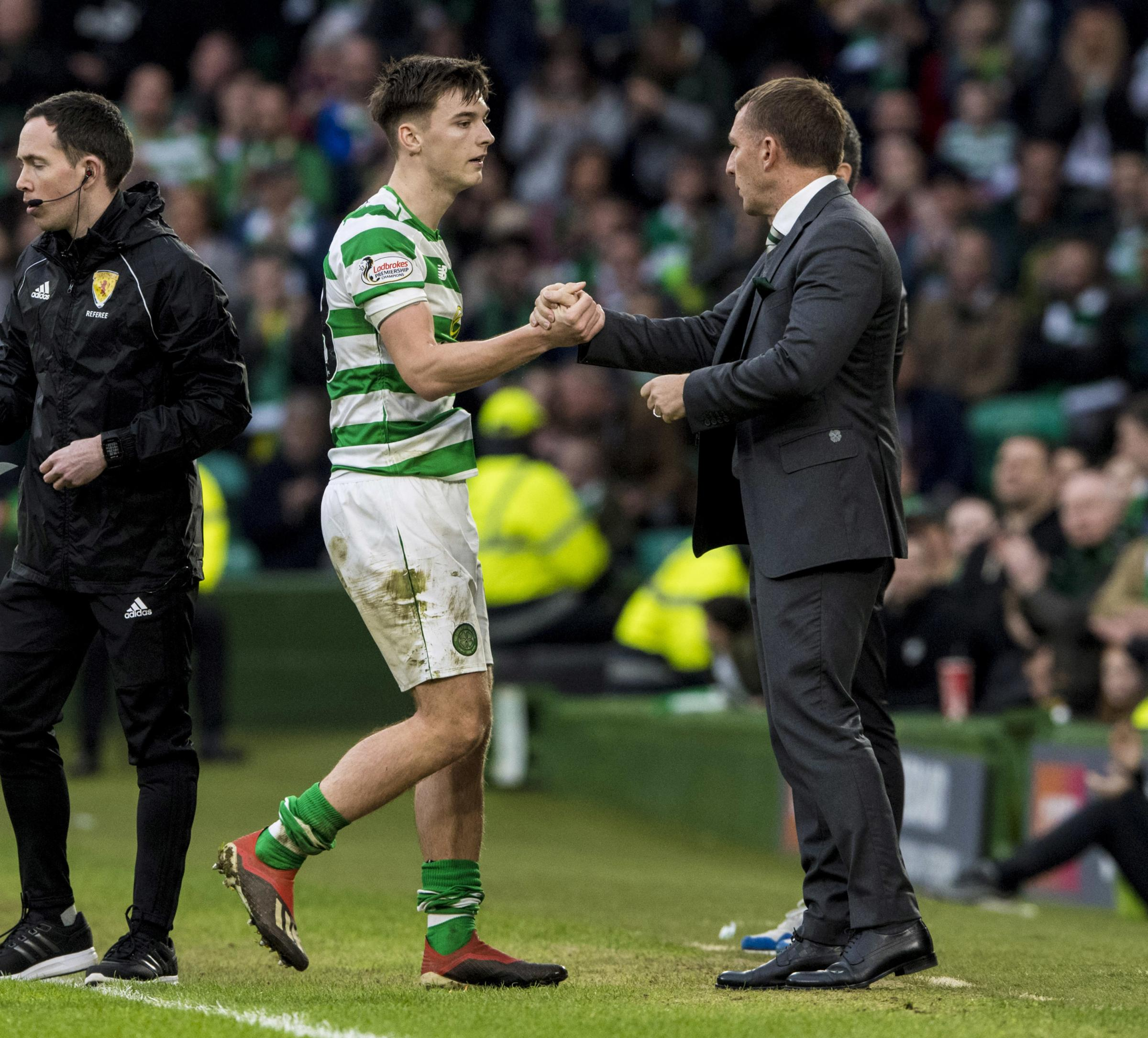 Brendan Rodgers shakes hands with Celtic left back Kieran Tierney last month.