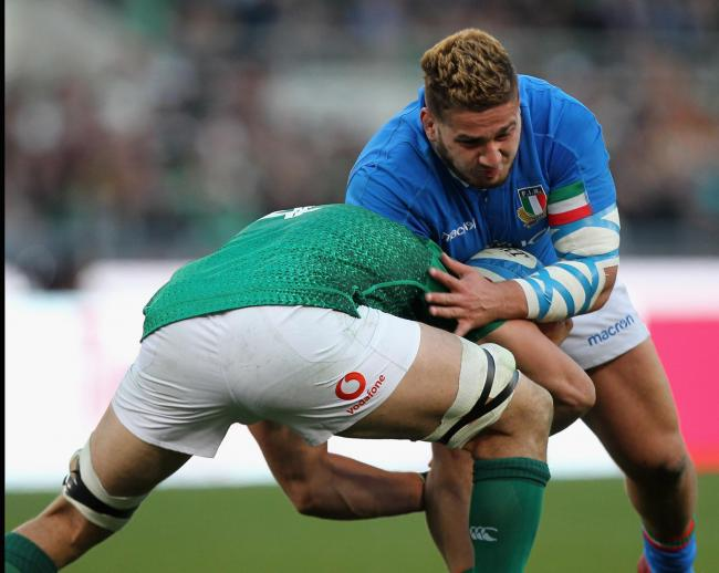 Tiziano Pasquali, playing for Italy, is tackled by Ireland's Ultan Dillane during their Guinness Six Nations match last weekend