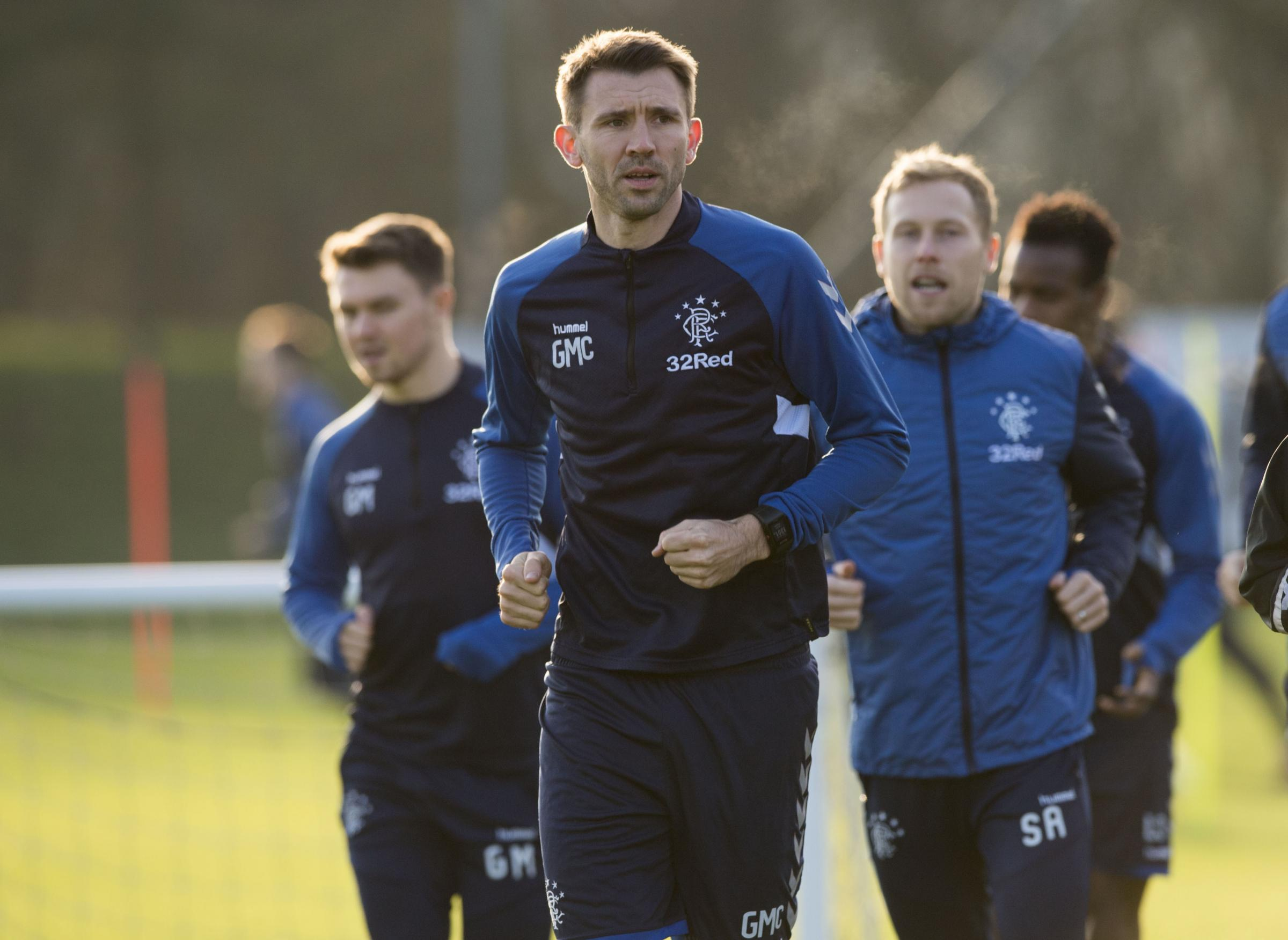 Rangers' Gareth McAuley (centre) leads the way in training