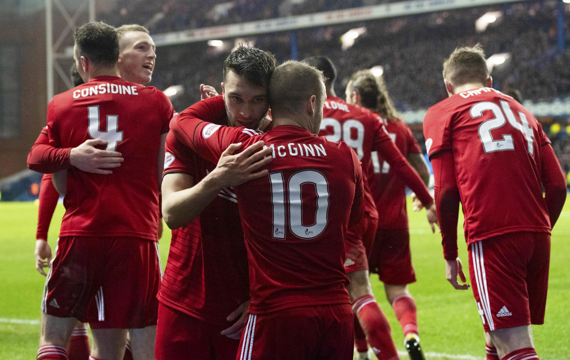 Aberdeen's Connor McLennan (left) celebrates with teammate Niall McGinn after his goal