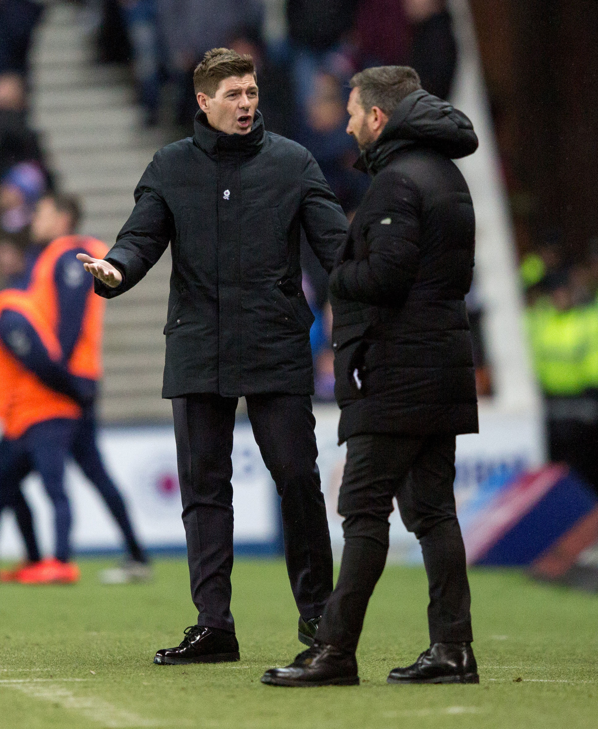 Rangers Manager Steven Gerrard and Aberdeen Manager Derek McInnes during the William Hill Scottish Cup quarter final replay match at Ibrox Stadium, Glasgow. PRESS ASSOCIATION Photo. Picture date: Tuesday March 12, 2019. See PA story SOCCER Rangers. Photo