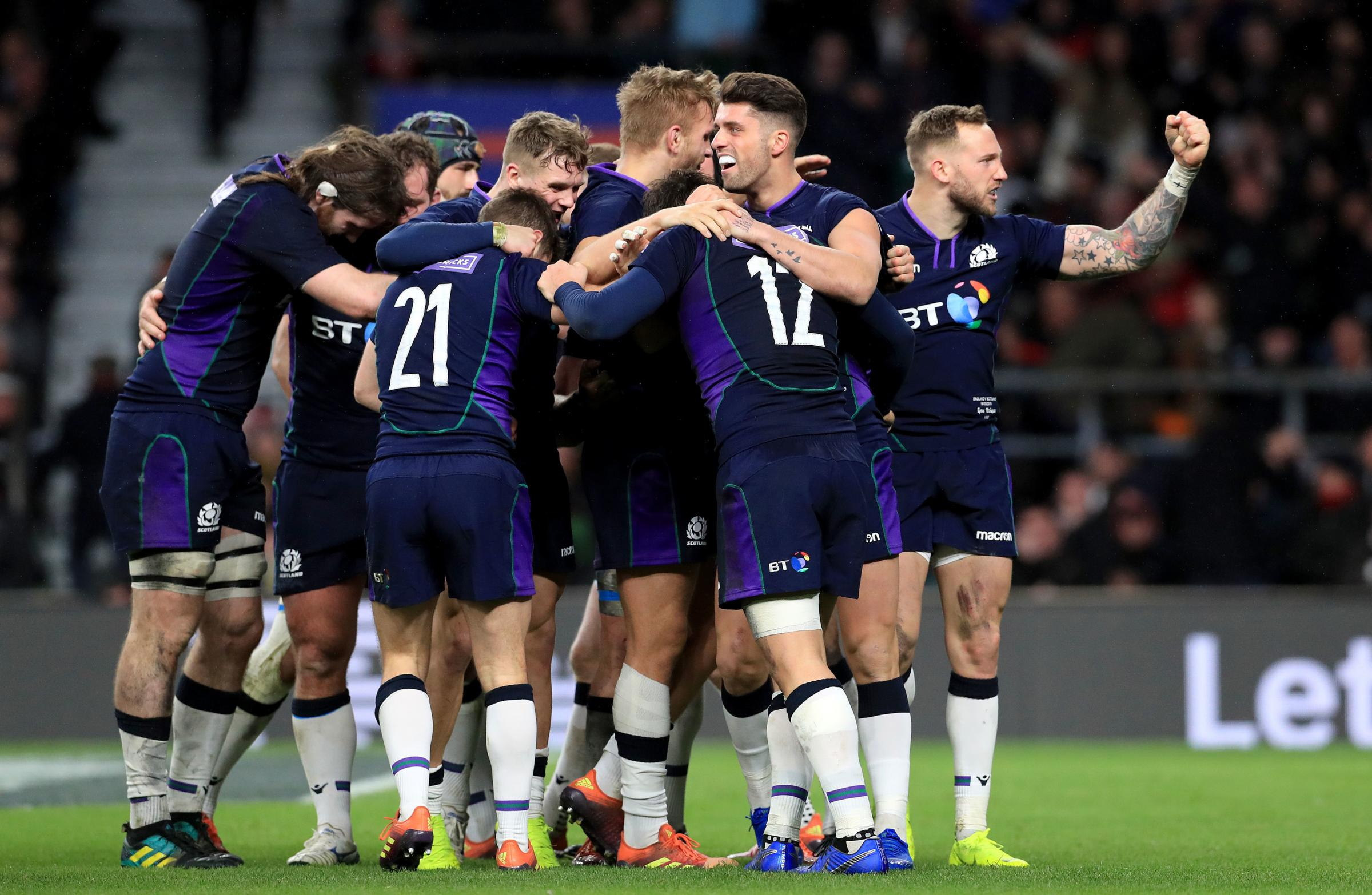 Scotland's Sam Johnson (12) celebrates with his team-mates after scoring his side's sixth try of the game during the Guinness Six Nations match at Twickenham Stadium, London. PRESS ASSOCIATION Photo. Picture date: Saturday March 16, 2019. See PA