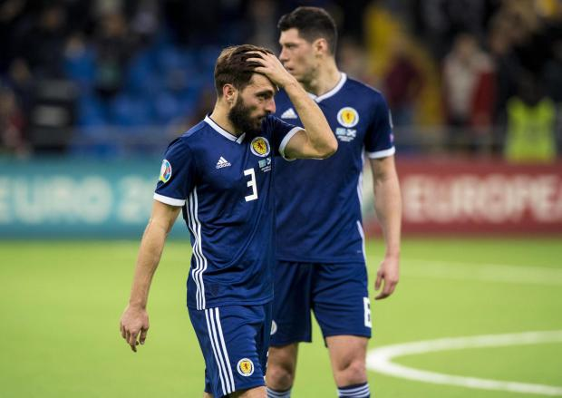 Evening Times: Graeme Shinnie cuts a dejected figure