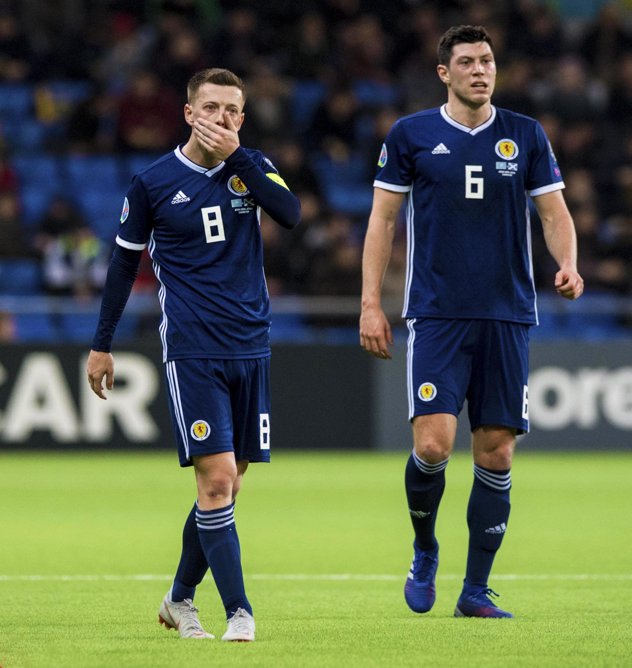 Scotland's Callum McGregor and Scott McKenna (R) show their frustration. Picture: SNS
