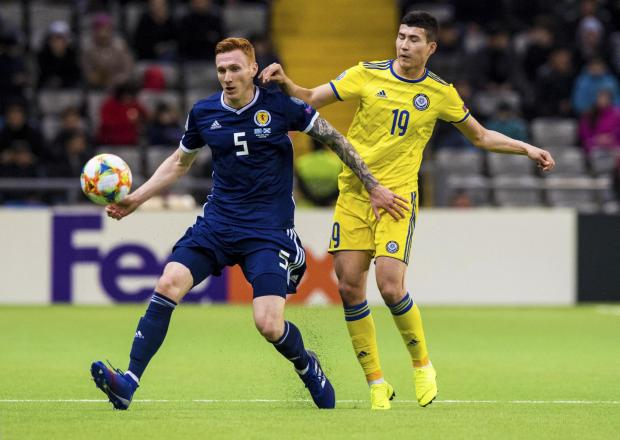 Evening Times: Scotland's David Bates (left) holds off Kazakhstan's Baktiyar Zaynutdinov