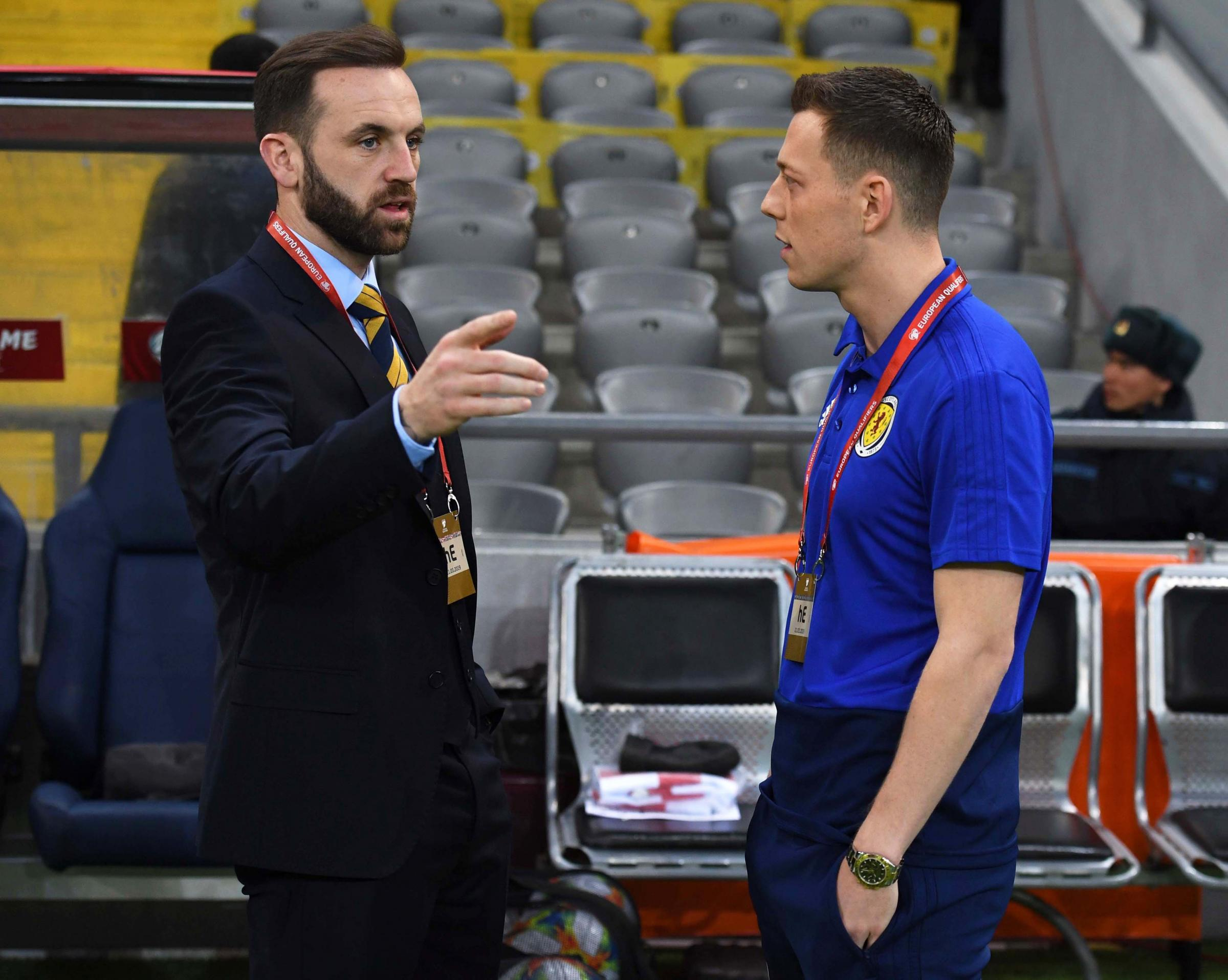 Scotland assistant manager James McFadden, left, in discussion with captain Callum McGregor..