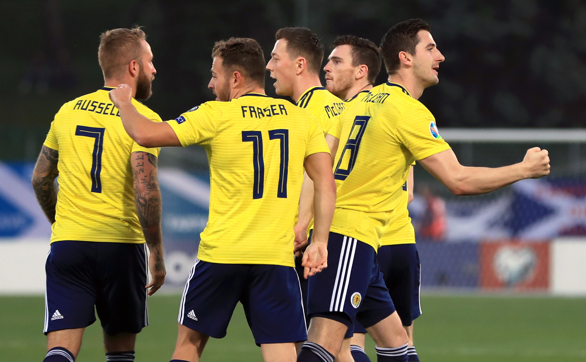 Scotland's Kenny McLean (far right) celebrates scoring his side's first goal of the game with team-mates during the UEFA Euro 2020 Qualifying, Group I match at the San Marino Stadium, Serravalle. PRESS ASSOCIATION Photo. Picture date: Sunday March