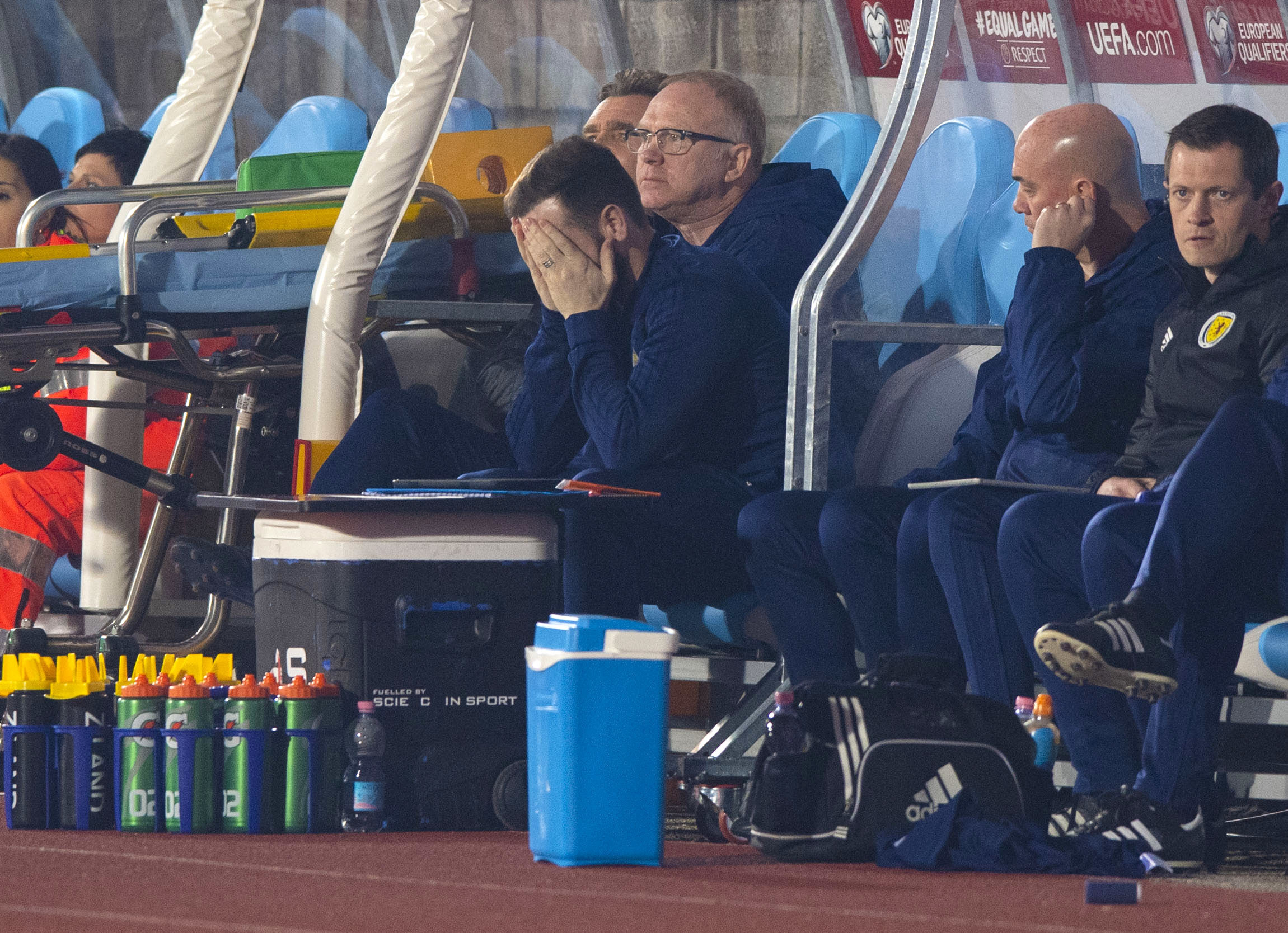 Scotland assistant manager James McFadden, left, shows his frustration as manager Alex McLeish watches on.
