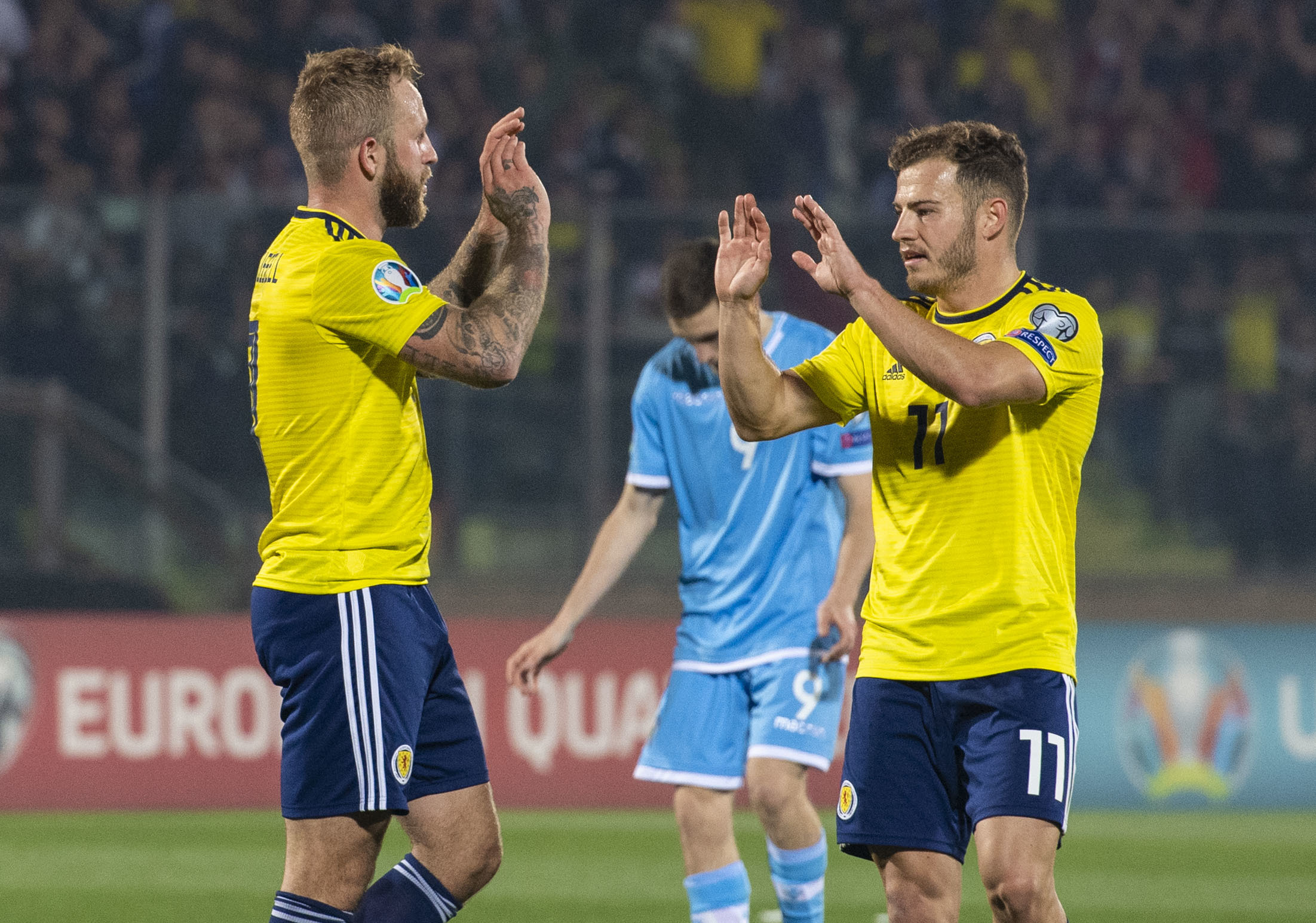 Scotland's Johnny Russell, left, celebrates his first goal for Scotland with Ryan Fraser.