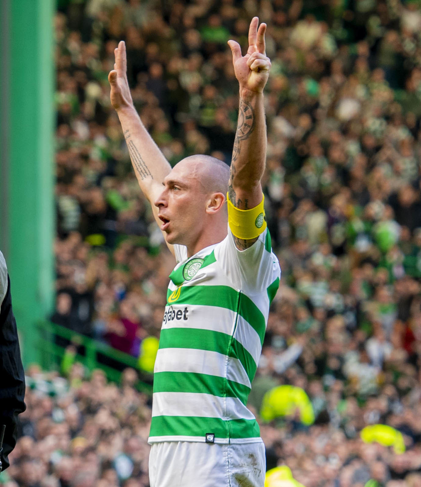 Scott Brown laps up Celktic's win over Rangers on Sunday.