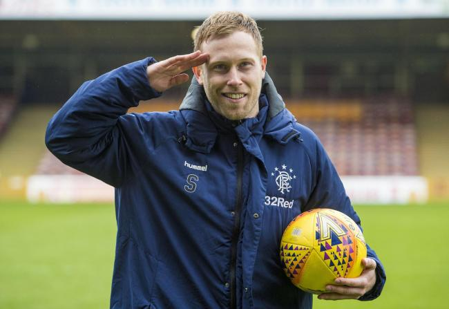 Scott Arfield salutes the Rangers fans with the match-ball after his hat-trick at Motherwell