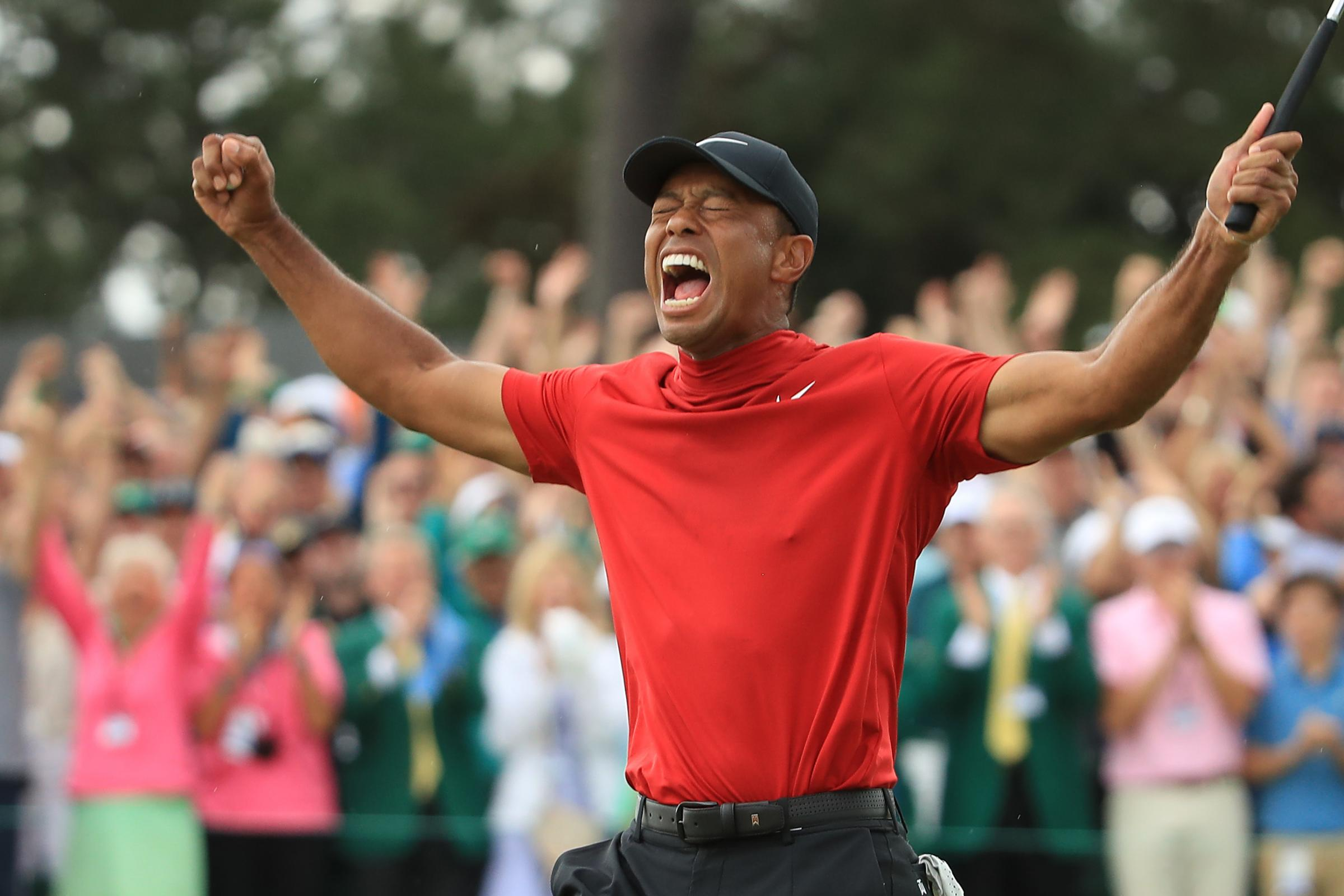 AUGUSTA, GEORGIA - APRIL 14: Tiger Woods of the United States celebrates after sinking his putt to win during the final round of the Masters at Augusta National Golf Club on April 14, 2019 in Augusta, Georgia. (Photo by Andrew Redington/Getty Images).