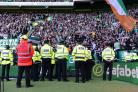 Police stand in front of The Green Brigade during Celtic match against Rangers at Parkhead last month.
