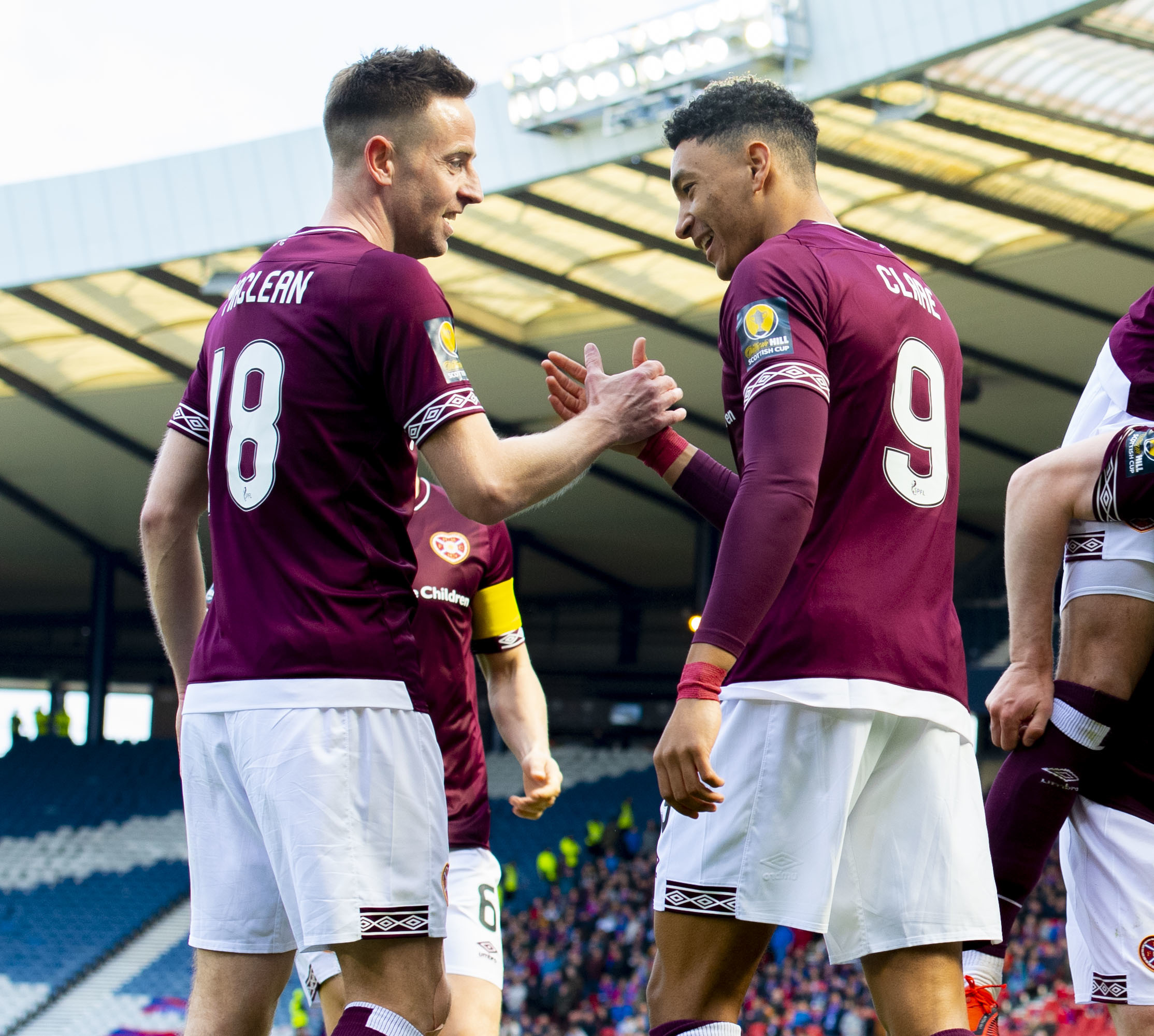 Hearts' Sean Clare (right) celebrates with Steven MacLean