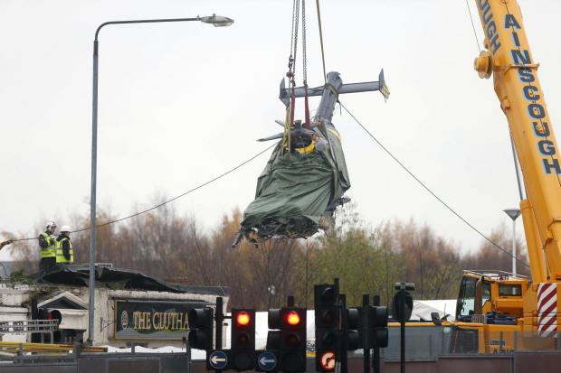 Photo: Colin Templeton....Clutha crash. The helicopter is lifted from the pub.....Photo: COLIN TEMPLETON.