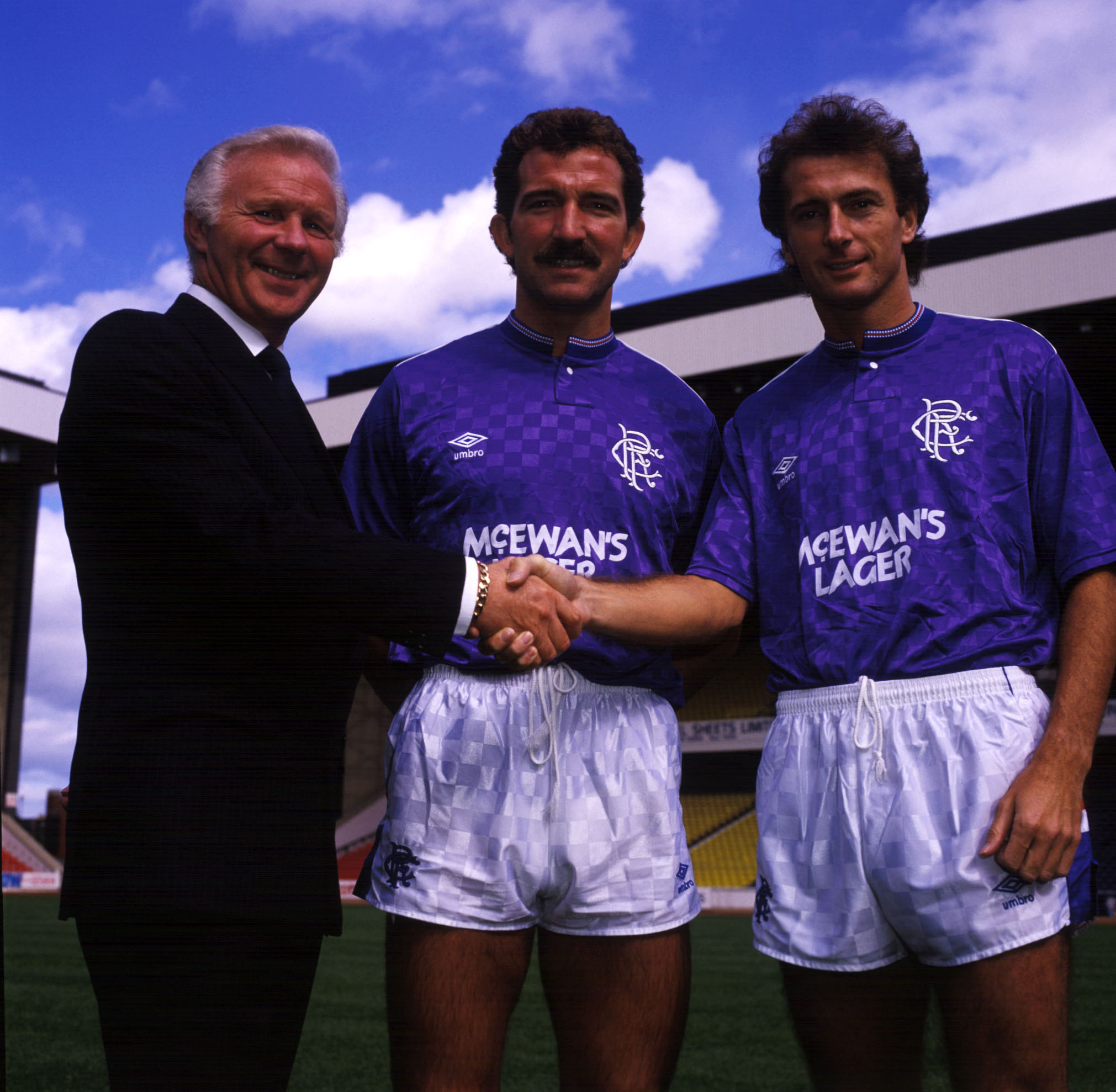 Trevor Francis (right) is welcomed by Ibrox by chairman David Holmes and player/manager Graeme Souness