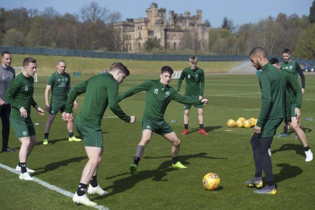 Evening Times: Celtic players train at Lennoxtown