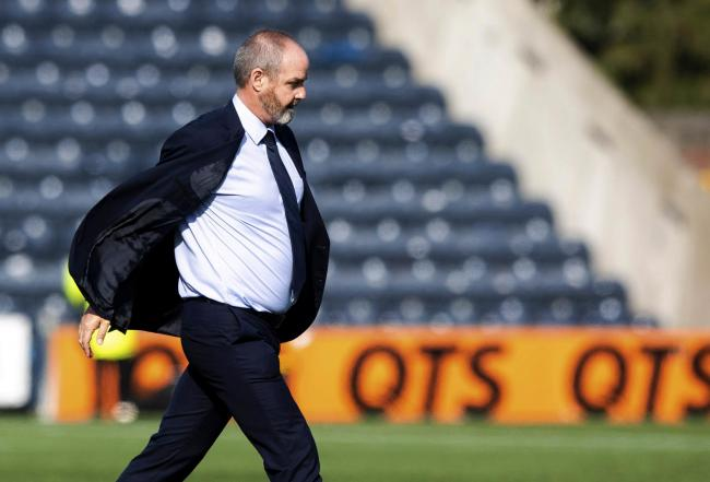 Steve Clarke marches onto the Rugby Park pitch to confront referee Steven McLean.