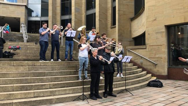 Musical flashmob stuns Glasgow crowd in campaign against tuition cuts