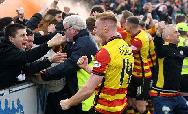 The Partick Thistle players celebrate with their supporters after Stuart Bannigan's penalty put the result beyond doubt at Palmerston.