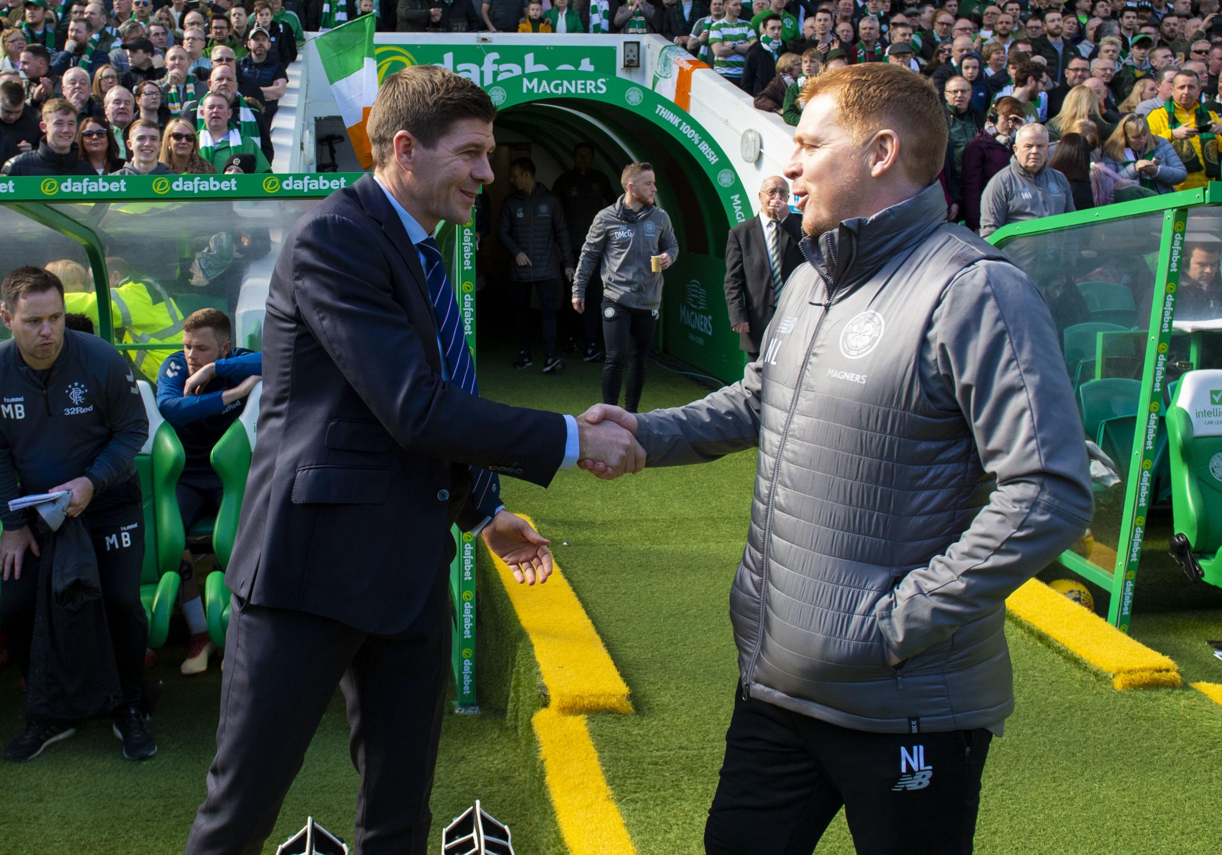 Rangers manager Steven Gerrard, left, shakes hands with Celtic manager Neil Lennon at Parkhead in March.
